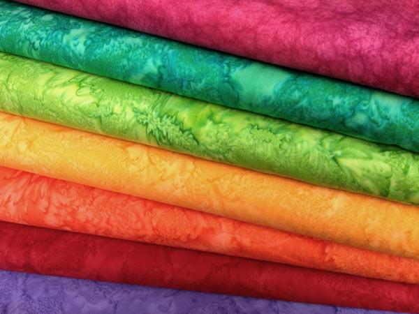 Tintura-stoffe-colorate-verde-viola-marrone